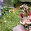 Gloucester: Lily Russo, 22 months, of Hamilton walks around with a cup a fairy tea while attending the 4th annual Fairy Festival held at Underwood Photography in Essex Saturday afternoon.  Activities included playing dress up in fairy costumes, decorating fairy houses, fairy tea parties and having your picture taken in your fairy costume.   Part of the proceeds from the festival went to benefit Habitat for Humanity. <br /> Photo by Mary Muckenhoupt/Gloucester Daily Times Saturday, June 16, 2007