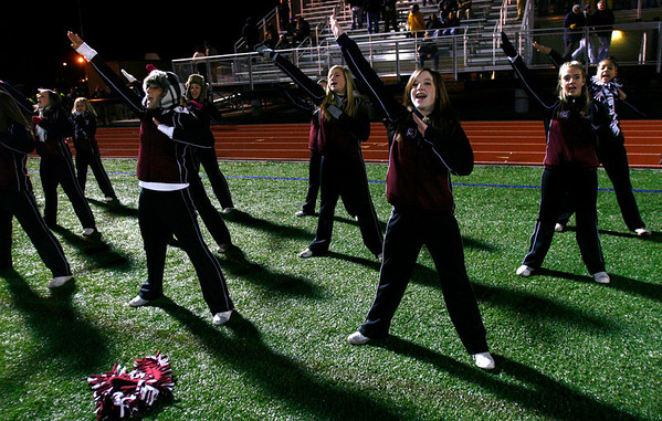Gloucester Cheerleaders root for the Fishermen during their Division 2A playoff game against Masconomet at Manning Field in Lynn last night. Photo by Kate Glass/Gloucester Daily Times