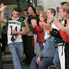 Manchester: Football captain Pat Orlando receives a high five from Lauren Dubois after being announced into the gymnasium at Manchester Essex High School Friday afternoon.  The school held a pep rally for the Hornets before their Super Bowl game at Gillette Stadium tomorrow morning. Mary Muckenhoupt/Gloucester Daily Times