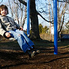 Gloucester: Emmett Henry Caldwell, 6, swings at Rebecca's Playground in Gloucester yesterday afternoon. He and his sister were spending some time outside during their winter break while the warm weather lasts. Photo by Kate Glass/Gloucester Daily Times Monday, December 29, 2008