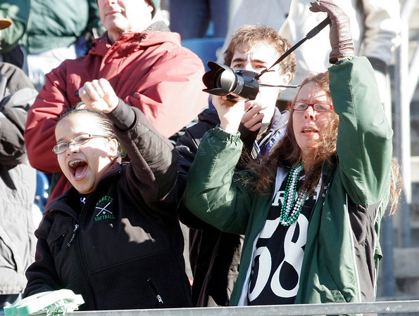Ysee Gedeon, Vernon Klypka-Simpson, and Marilyn Klypka-Simpson, cheer for the Manchester Essex Hornets during their Super Bowl game against the Tri-County Cougars at Gillette Stadium on Saturday. Photo by Kate Glass/Gloucester Daily Times Saturday, December 6, 2008