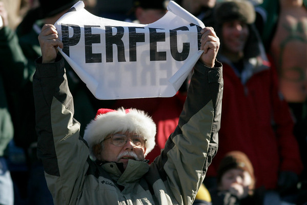 "Jerry Houle of Gloucester holds up a sign saying ""PERFECT"" during the Manchester Essex Division 4 Super Bowl win over Tri-County at Gillette Stadium on Saturday. Photo by Kate Glass/Gloucester Daily Times Saturday, December 6, 2008"
