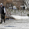 Rockport: Doug Opie walks with his dogs, Cash, left, and Yogi, right, along Granite Pier on Tuesday afternoon. Both dogs enjoy the snow and Yogi even swims in winter. Photo by Kate Glass/Gloucester Daily Times Tuesday, December 22, 2008