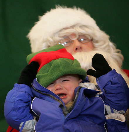 Manchester: Rocky Pratt, 1 year, cries for his mother in an attempt to get a family portrait with Santa at the Manchester Community Center Saturday afternoon.  Mary Muckenhoupt/Gloucester Daily times