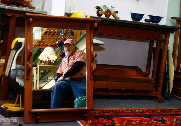 Gloucester: Ed Soucy, artist and owner of the Menage Gallery on Main Street, says he has been making smaller items due to the economy, but overall business has been ok. Photo by Kate Glass/Gloucester Daily Times Wednesday, December 17, 2008