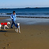 Manchester: Julie Spintig of Manchester walks with her two dogs, Charlie and Abby, at Singing Beach yesterday. Many people were out despite the frigid temperatures. Photo by Kate Glass/Gloucester Daily Times Monday, December 22, 2008