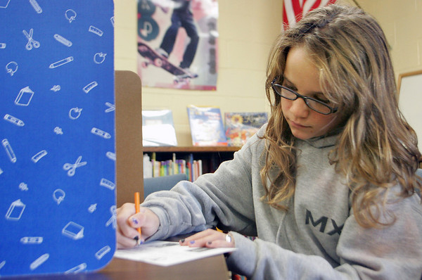 Essex: Sam Woodman, a sixth grader at Essex Elementary School, votes during the mock presidential election in the school's library Thursday afternoon. Mary Muckenhoupt/Gloucester Daily Times.