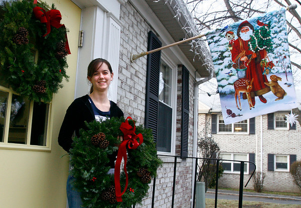 Essex: Ruby Allen, a junior at Manchester Essex Regional High School, donated 11 wreaths to Chebacco Terrace in Essex to help them decorate for the holidays. Allen sold the wreaths as part of the DECA Project and said many people donated money instead of buying wreaths so she gave the extras to the housing complex. Photo by Kate Glass/Gloucester Daily Times Monday, December 15, 2008