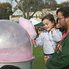 Essex: Corina Reeves, 3, of Manchester takes her cotton candy after her dad, Steve, held her up so she could watch it being made at the Essex Clam Fest at Memorial Park Saturday afternoon.  Mary Muckenhoupt/Gloucester Daily Times