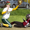 Gloucester: Gloucester High School's Kelly Benson slides safely into third as Lynn Classical's Hannah Burns catches the ball at Burnham's Field Monday. Gloucester lost the softball game 15-3.<br /> Photo by Mike Dean/Gloucester Daily Times Monday, May 05, 2008