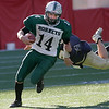 Manchester Essex's Brian Pat Orlando drags a Tri-County player with him as he runs the ball during their Super Bowl game at Gillette Stadium on Saturday. Photo by Kate Glass/Gloucester Daily Times Saturday, December 6, 2008