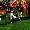 Gloucester: Gloucester's Ross Carlson, Giacomo Romeo, and Joseph Falzarano rush onto the field for their game against Masconomet on Tuesday night. Photo by Kate Glass/Gloucester Daily Times Wednesday, December 3, 2008
