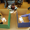Essex: From left, sixth graders Katie Glidden, Breanna Arnold and Louisa Spofford cast their vote during the mock  presidential election held in the library of Essex Elementary School Thursday afternoon. Mary Muckenhoupt/Gloucester Daily Times