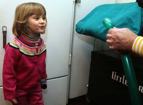 Rockport: Sofia Parillo, 3, of Rockport blows on a balloon to make it grow into a flower during Rockport's New Year's Eve festivities last night. Many people braved the storm to join in the celebration. Photo by Kate Glass/Gloucester Daily Times Wednesday, December 31, 2008