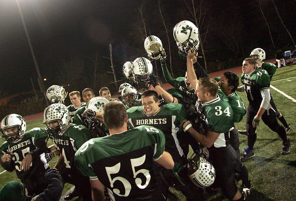 Manchester: Manchester Essex celebrates after their win against O'Bryant in the Division 4 football playoff game held at Reading High School Tuesday night.  <br /> Photo by Mary Muckenhoupt/Gloucester Daily Times Tuesday, December 02, 2008