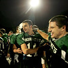 Manchester: Manchester Essex's Pat Orlando, center, is congratulated by teammate Ben Kekeisen after their win against O'Bryant in the Division 4 football playoff game held at Reading High School Tuesday night.  <br /> Photo by Mary Muckenhoupt/Gloucester Daily Times Tuesday, December 02, 2008