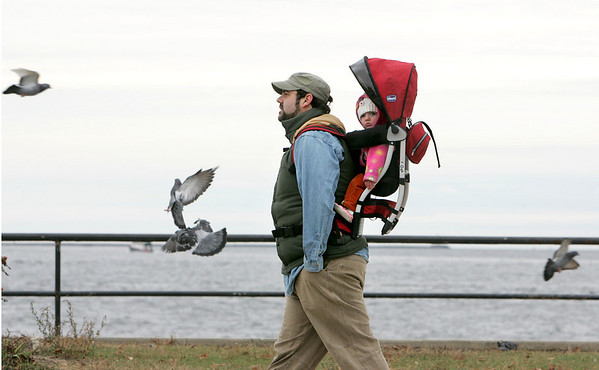 Gloucester: Garrett Sidmore of Gloucester walks with is daughter Ophelia, 10 months,  on Satcy Boulevard Thursday afternoon.  Mary Muckenhoupt/Gloucester Daily Times<br /> Photo by Mary Muckenhoupt/Gloucester Daily Times Thursday, November 13, 2008