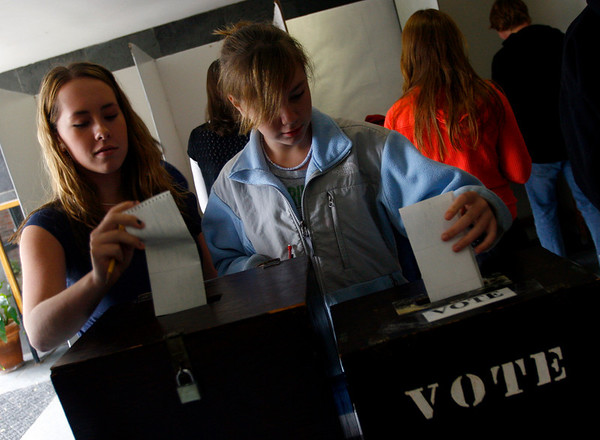 """Manchester: Kelly McIntosh and Devin Kelley, both 8th graders at Manchester Essex, cast their ballots during their schoolwide """"mock election"""" on Wednesday. Students voted using samples of the Manchester ballot and had been over all the races and ballot questions in social studies classes. Photo by Kate Glass/Gloucester Daily Times Wednesday, October 29, 2008"""