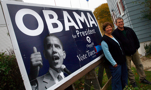"""Gloucester: Debbie and Paul Frontierro, who have one of the largest campaign signs in the area outside their home on Washington Street in Gloucester, said they will leave their sign up for a couple days to celebrate Obama's victory. Debbie says he is """"redefining America as a more univied, more diferse nation with common values among it's people,"""" adding that it was great seeing a candidate who got young people so excited and involved with the election. Photo by Kate Glass/Gloucester Daily Times Wednesday, November 5, 2008"""