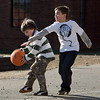 Rockport: Adam Ramsden, 7, left, tries to keep the ball away from his brother Cory, 11, while playing basketball with friends after school behind Rockport Elementary School Thursday afternoon.  Mary Muckenhoupt/Gloucester Daily Times