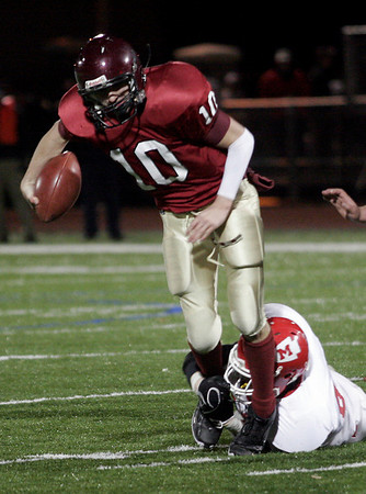 Gloucester quarterback Rick Gallant breaks a tackle as he runs the ball during their 26-7 win over Masconomet in the Division 2A playoffs at Manning Field last night. Photo by Kate Glass/Gloucester Daily Times Tuesday, December 2, 2008