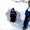 Gloucester: Andrew Greige, 13, left, and Kevin Riley, 13, build a snow fort in one of several large piles of snow on Gloucester Ave yesterday afternoon. Photo by Kate Glass/Gloucester Daily Times Monday, December 22, 2008