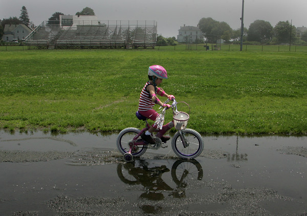 Gloucester: Sophia Mustone, 5, rides her bike around the track at Newell Stadium Friday afternoon.  Sophia, with the help of her mom, organized the first Pan-Mass Challenge cycling event for kids to be held at Endicott College this September. Sophia wanted to organize an event to help her grandfather who is sick with cancer. Mary Muckenhoupt/Gloucester Daily Times