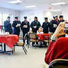 Gloucester: Marty Langois, a nurse practitioner at Elder Services Plan of the North Shore, takes pictures as Gloucester Firefighters sing Christmas Carols with Santa yesterday morning. The firefighters drove all around Gloucester caroling. Photo by Kate Glass/Gloucester Daily Times Monday, December 22, 2008