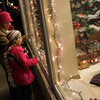 Rockport: Lauren Penta and her daughter Emily, 8, look at a Christmas village in a storefront window on Main Street in Rockport Saturday night. The two were on their way back from the Rockport tree lighting when they stopped to do a little window shopping. Mary Muckenhoupt/Gloucester Daily Times