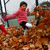 Manchester: Remsen Demeo, 4, left, Ava Pick, 4, center, and Gwen Hannafin, 4, kick leaves at the Brook Street Playground while waiting for their siblings to get out of school on Thursday. The three kicked the leaves into a big pile to jump in. Photo by Kate Glass/Gloucester Daily Times Thursday, October 13, 2008