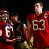 Gloucester captains Robbie Lowe and Dylan Morrissey accept the Super Bowl finalist trophy with head coach Paul Ingram, center, following their 46-26 loss to Duxbury in the Division 2A Super Bowl at Gillette Stadium on Saturday. Photo by Kate Glass/Gloucester Daily Times Saturday, December 6, 2008