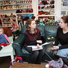 Gloucester: Laurel McDonald, right, assists Amy Smith of Gloucester at Coveted Yarn, a new knitting shop in East Gloucester.  McDonald and her husband Robert Porter have opened the shop which is the only place one can find knitting supplies on Cape Ann. Also pictured is Evelyn Porter,  1 year, left. Mary Muckenhoupt/Gloucester Daily Times