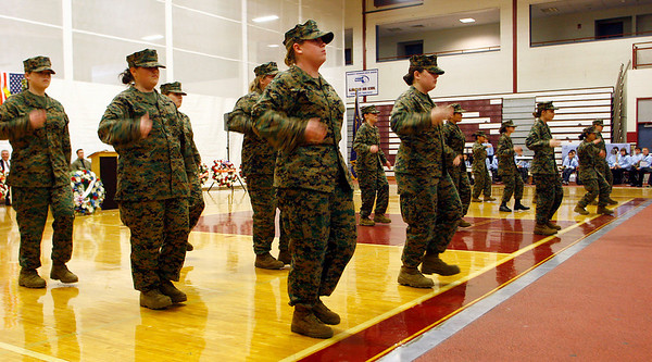 Gloucester: Members of the Gloucester High School MCJROTC perform a drill demonstration during Gloucester's Veterans Day ceremony at the Benjamin Smith Field House yesterday. Photo by Kate Glass/Gloucester Daily Times Tuesday, November 11, 2008