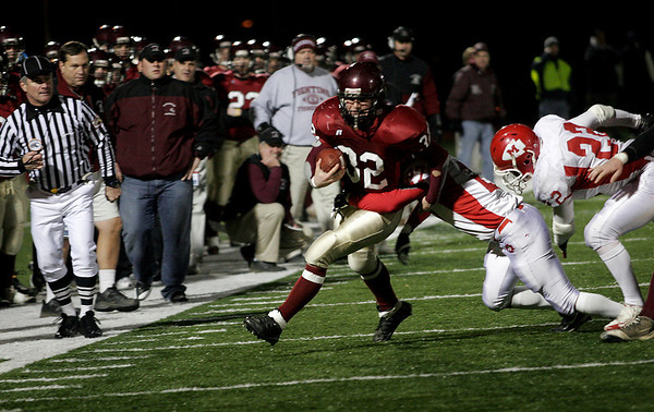 Gloucester's Conor Ressel breaks a tackle during their Division 2A playoff game against Masconomet last night. Ressel scored two touchdowns in the Fishermen's 26-7 win. Photo by Kate Glass/Gloucester Daily Times Tuesday, December 2, 2008
