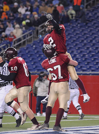 Gloucester's Ross Carlson celebrates his touch down in the endzone with teammate Robert Lowe agianst Duxbury High School in the Division 2A Superbowl game at Gillerre Stadium in Foxboro Mass Saturday night December 6,2008.