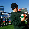 Cosmo Palazola, 8, fills water bottles for the Manchester Essex football team during during their Super Bowl game against the Tri-County Cougars at Gillette Stadium on Saturday. Photo by Kate Glass/Gloucester Daily Times Saturday, December 6, 2008