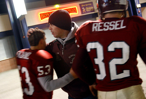 Former Gloucester football captain Andrew Fulford greets Joe Falzarano and Conor Ressel following their 46-26 loss to Duxbury in the Division 2A Super Bowl at Gillette Stadium on Saturday. Photo by Kate Glass/Gloucester Daily Times Saturday, December 6, 2008