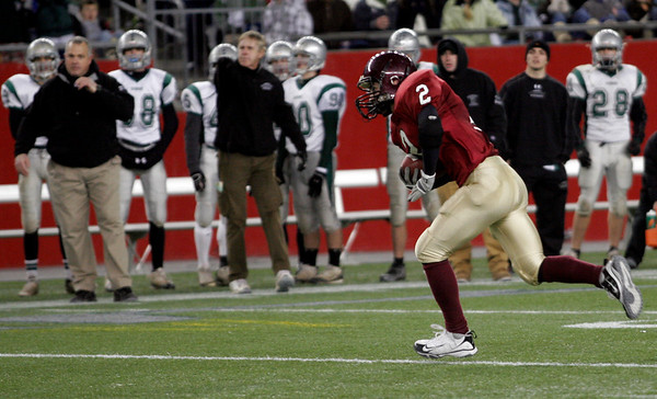 Gloucester's Ross Carlson intercepts a pass thrown by Duxbury  quarterback Sean Cross during the Division 2A Super Bowl at Gillette Stadium on Saturday. The Fishermen lost 46-26. Photo by Kate Glass/Gloucester Daily Times Saturday, December 6, 2008