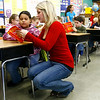 Gloucester: Shannon O'Donnell of Gloucester High School's Interact Club helps Crisbel Mercado, a student in Gina Sargent's third grade class at West Parish Elementary School, learn to use a dictionary yesterday morning. The club, which is sponsored by the Rotary Club, raised money to buy dictionaries for every third grader in Gloucester schools. Photo by Kate Glass/Gloucester Daily Times Wednesday, December 3, 2008