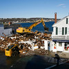 Rockport: Workers hose down the street as the remaining sections of the Haskins building come down yesterday morning. The road was open after 4 hours. Photo by Kate Glass/Gloucester Daily Times Tuesday, November 18, 2008