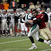 Gloucester's Brett Cahill attempts to sack Duxbury quarterback Sean Cross during the Division 2A Super Bowl at Gillette Stadium on Saturday. Ross Carlson completed the sack. Photo by Kate Glass/Gloucester Daily Times Saturday, December 6, 2008