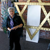 Gloucester: Carole Sharoff, co-president of Temple Ahavat Achim sits with several artifacts that they were able to salvage from the Middle Street fire. On the left is a rendering of the burning bush and right is the Star of David that hung at the top of the temple. Photo by Kate Glass/Gloucester Daily Times Monday, December 8, 2008