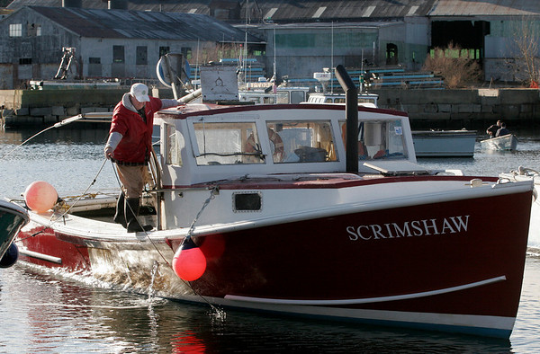 Rockport: John Halmen of Rockport prepares his boat, the Scrimshaw, to be pulled in from Pigeon Cove for winter after his last day of lobstering yesterday. Photo by Kate Glass/Gloucester Daily Times Monday, December 29, 2008