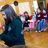 Essex: Megan Gavin plays the piano during Essex Elementary School's hidden talents spirit day on Monday. Students played instruments, sang, danced, drew, and even rapped during the event. Photo by Kate Glass/Gloucester Daily Times Monday, December 8, 2008