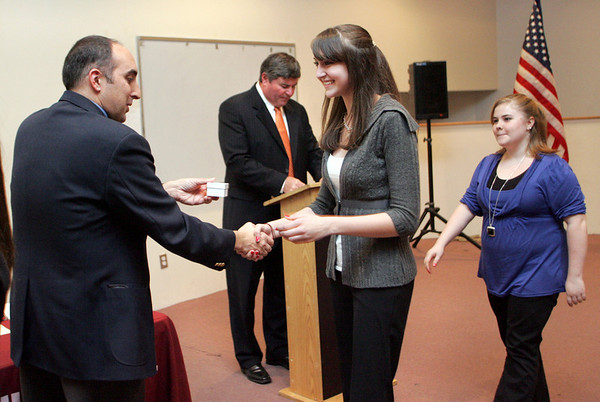 Gloucester:  Melissa Aptt, a freshman at Gloucester High School, receives a Sawyer Medal from Greg Verga during the Sawyer Medal awards ceremony at Gloucester High School Wednesday night.  Also photogrpherd is Gloucester High School Principal William Goodwin and Katina Tibbetts, right. Mary Muckenhoupt/Gloucester Daily Times