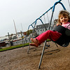 Gloucester: Anna Brancaleone, 2, smiles as she swings at the Benjamin Smith Playground in East Gloucester on Wednesday. Photo by Kate Glass/Gloucester Daily Times November 5, 2008
