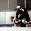 Gloucester: Gloucester's Josh Salah gets knocked over by Beverly's Nick Quartarone during their game in the Cape Ann Savings Bank Holiday Tournament at the Talbot Rink last night. Photo by Kate Glass/Gloucester Daily Times Monday, December 29, 2008