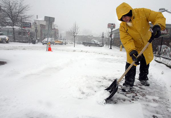 Gloucester: Claudio Paulo of Gloucester shovels snow from the sidewalk near the Walgreens Plaza during yesterday's blizzard. The snow from this storm was much lighter than the last one, making cleanup a bit easier. Photo by Kate Glass/Gloucester Daily Times Wednesday, December 31, 2008