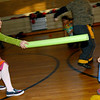 Rockport: Ariana Bouchie, left, tries to rescue Sophia Cucchiaro as they play Jedi Knights Dodge Ball during an after school program at Rockport Elementary School on Monday. Ariana was the Jedi Knight and she could rescue people who had been hit. Photo by Kate Glass/Gloucester Daily Times Monday, December 8, 2008