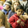 Gloucester: Ammar Syed, 8, of Gloucester touches one of the snakes that Rick Roth of the Cape Ann Vernal Pond Team brought to the Sawyer Free Library Sarurday morning.  Roth presented Snakes of Massachusetts and the World and brought out a variety of snakes in all sizes for kids to get a good look at up close. Mary Muckenhoupt/Gloucester Daily Times